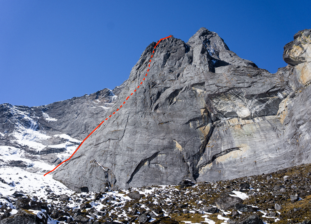 Lung-Ta Buttress seen from the north. The snow down low, adjacent to the route line, is the left side of the hanging glacier traversed to reach the main weakness on the face.