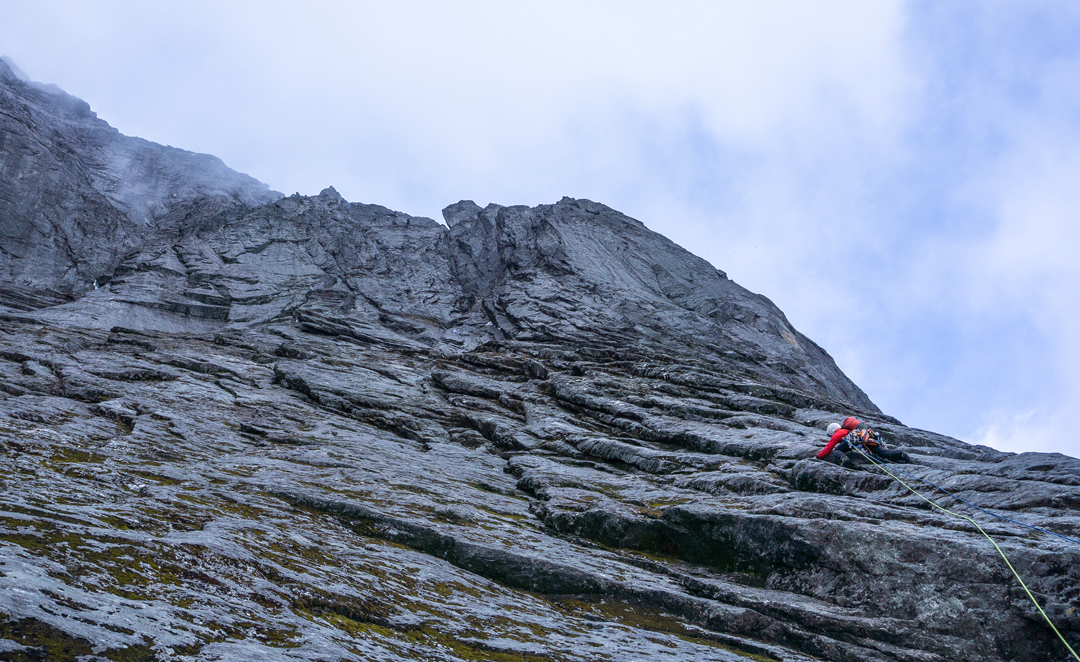 Zach Lovell heading out on pitch three of Lung-Ta Buttress in the Barun Valley.