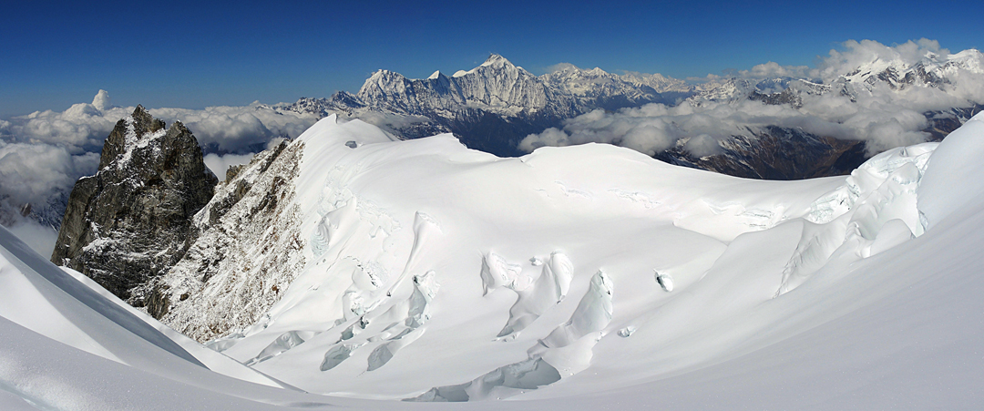 Looking almost west from the southwest face of Phungi after descending through the icefall. The prominent high peak is Annapurana II (7,937m), while the rounded, dome-like summit on the left (at the far end of Annapurna II southeast ridge) is Lamjung Himal (6,983m).