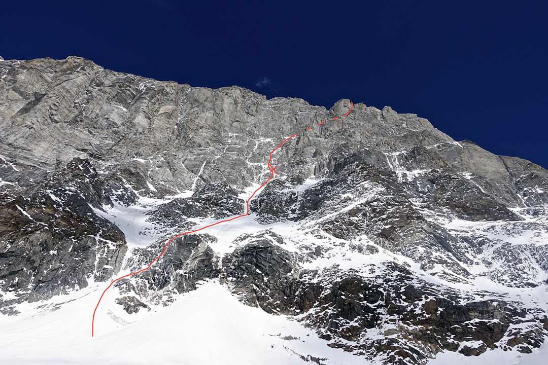 Looking up the lower section of the southwest face of Nilkanth with the line of the American route. The first bivouac is marked.