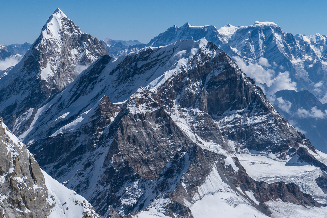 The elegant Nilkanth (far left) seen across the flanks of Parvati Parbat (6,257m) from the Chaukhamba Group to the west. The sharp west ridge of Nilkanth faces the camera, with the upper part of the southwest face immediately right. The high peaks behind the summit of Parvati Parbat belong to the massif containing Ghori Parbat (6,708m) and Hathi Parbat (6,727m, first climbed in 1963).