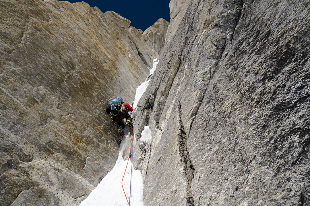 Chantel Astorga climbing a thin ice runnel on day three. This led to an overhanging alcove, a tension traverse, some mixed terrain, steep ice, and eventually the top of the Castle, a prominent rock formation, where the team bivouacked at 6,248m, having completed the crux of the route.