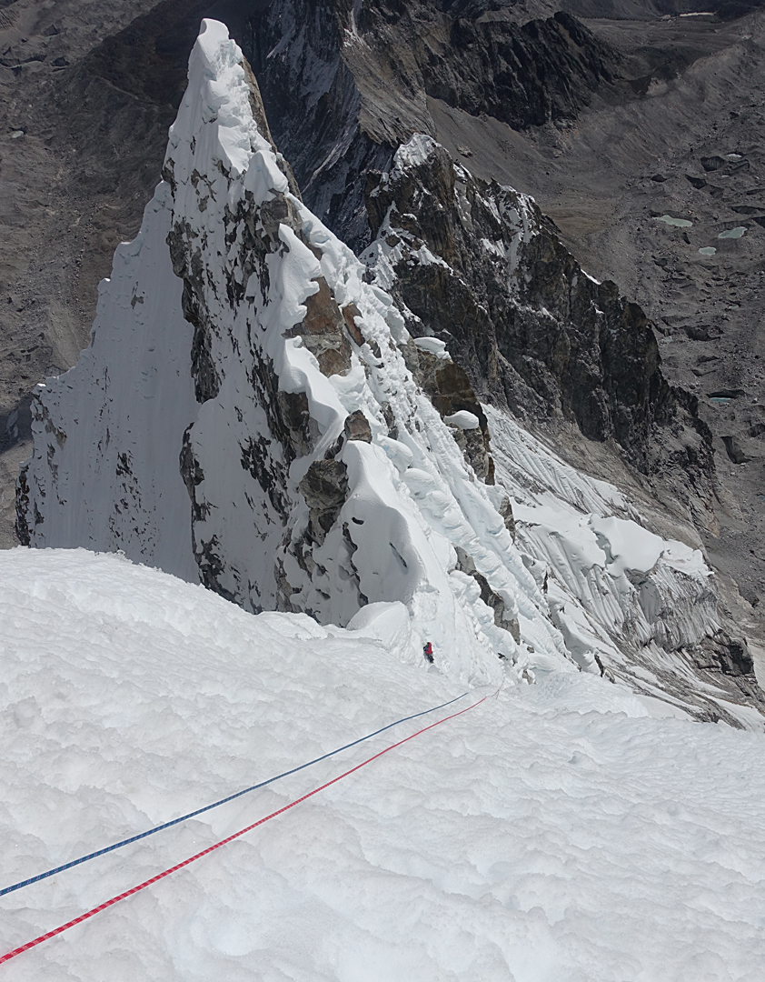 Max Bonniot just above the notch on the southeast ridge of Pangbuk North during the rappel descent near the steep, unprotectable snow the two had climbed earlier.