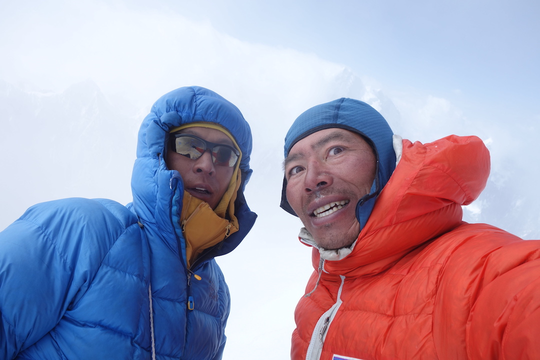 "Nagato (left) and Yokoyama on the summit. ""The K7 West traverse was the outcome of a lifetime of achievements in mountaineering."""