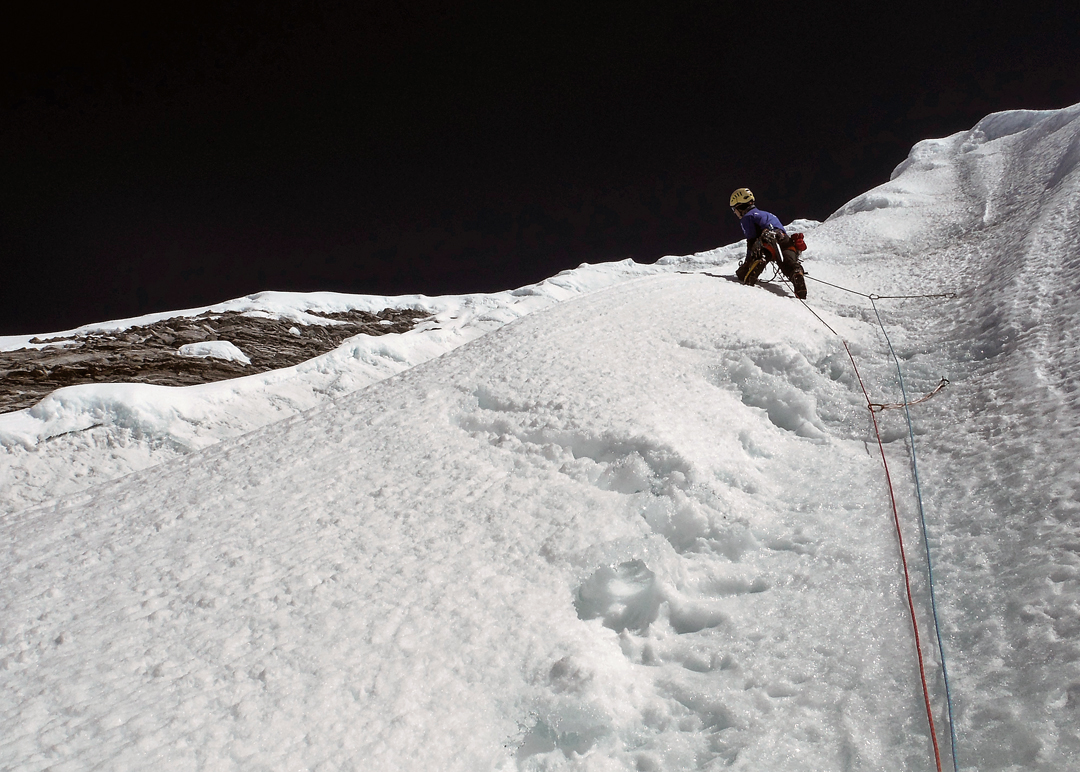 Climbing on the upper section of Danebat, west face of Chekigo Sano.