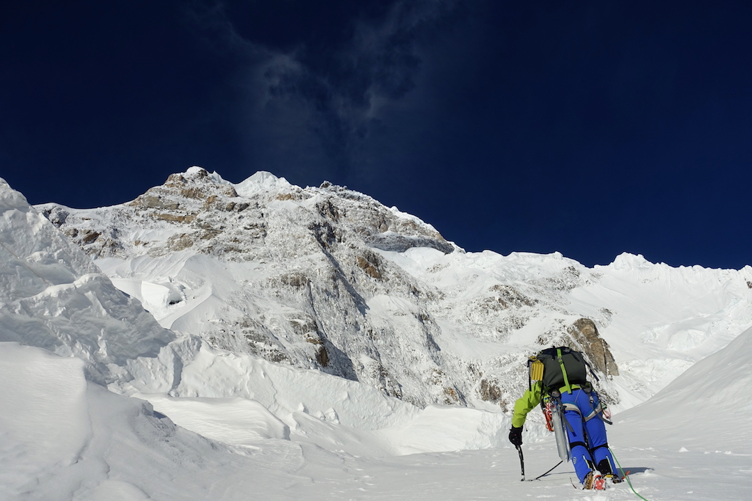 Starting the second day of the climb, with more than 2,000 meters of the northeast face still looming overhead. Camp 2 would be found amid the rocks in upper left.