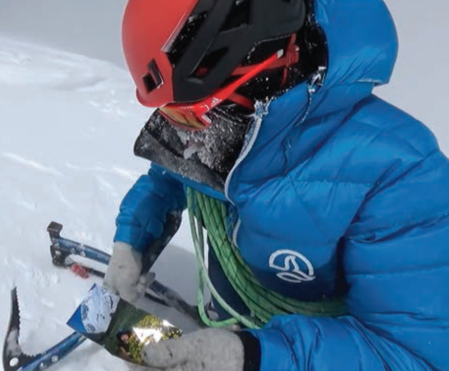 Hiraide prepares to leave a photo of Kei Taniguchi on the summit of Shispare. The two were favorite partners and had attempted Shispare in 2013. She died in a climbing accident in Japan in 2015.