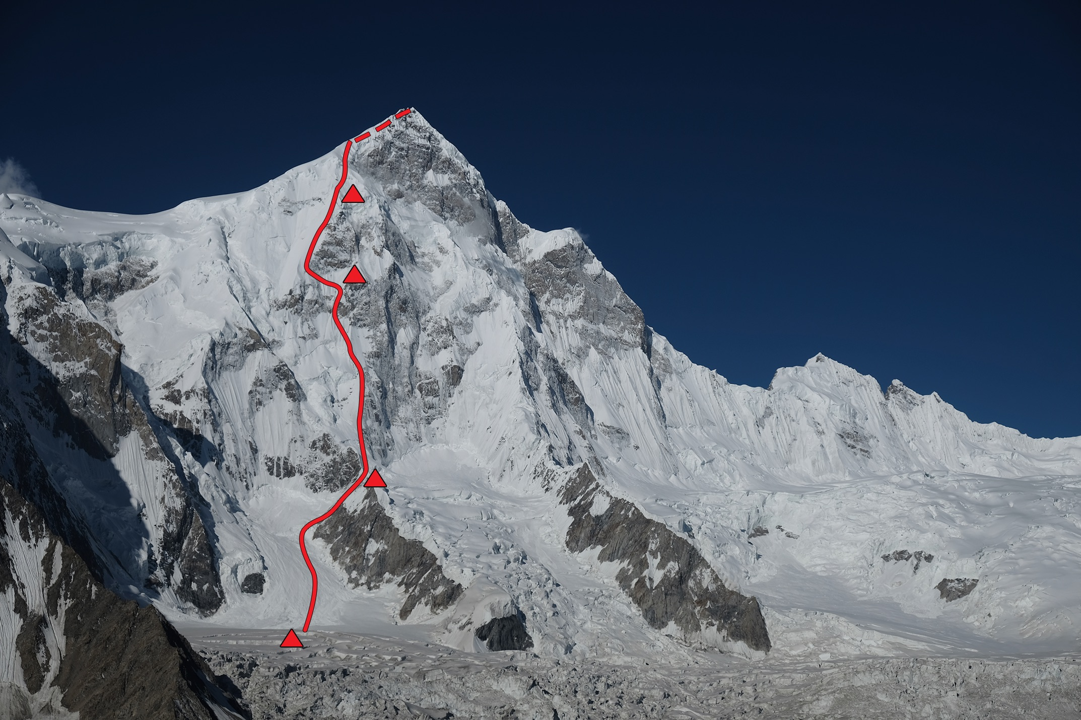 """The northeast face of Shispare (7,611 meters) and the line of Shukriya (""""Thanks""""). Hiraide and Nakajima bivied four times on the face, including two nights at the highest camp shown, plus two more nights during the descent. The mountain had only been climbed twice before, both times by the eastern ridge (left), which is the route the 2017 climbers descended."""