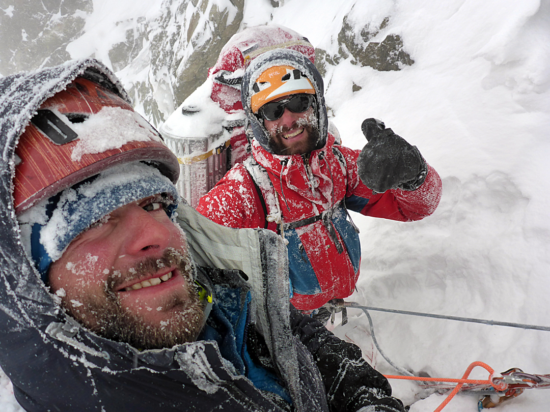 Archil Badriashvili and Giorgi Tepnadze enduring harsh conditions during the first winter ascent of the south face of Shkhara.