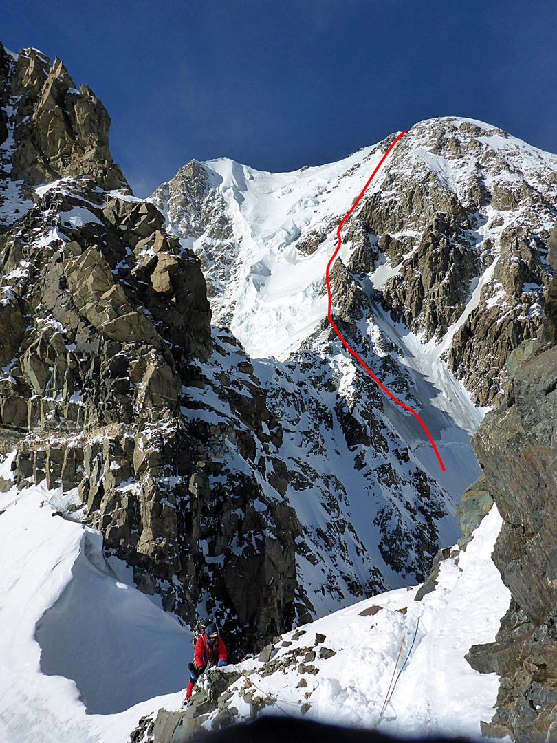 Giorgi Tepnadze on the south-southeast ridge of Shkhara. To bypass the large gendarme behind him, the climbers descended into the glacier basin to the right (northeast), then climbed back up to the crest and on to the summit via the route marked.