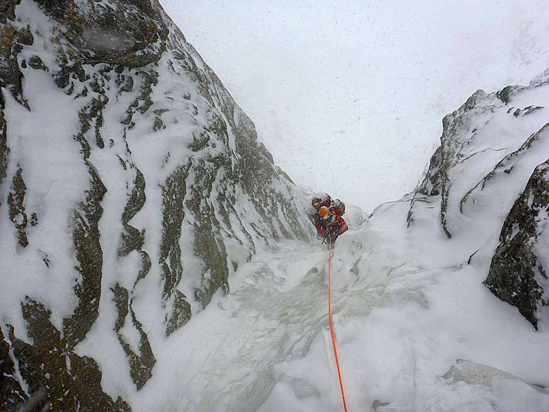 Giorgi Tepnadze ascends a narrow ice gully on the fourth day of the first ascent of the south face of Shkhara in winter.