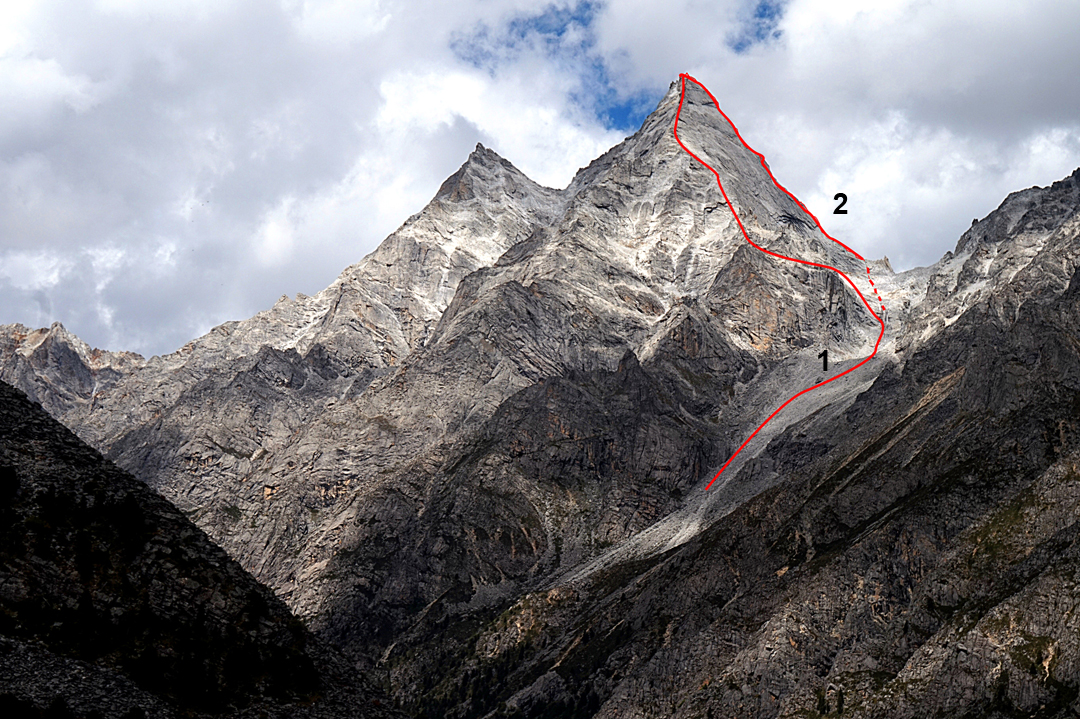 Kemailong from the south. (1) South ridge (ca 1,000m, 5.10 M5, Anderson-Yi, 2012). (2) East ridge (On the Way to Amsterdam, 970m, 6b A2, Chibitok-Kopteva, 2017).