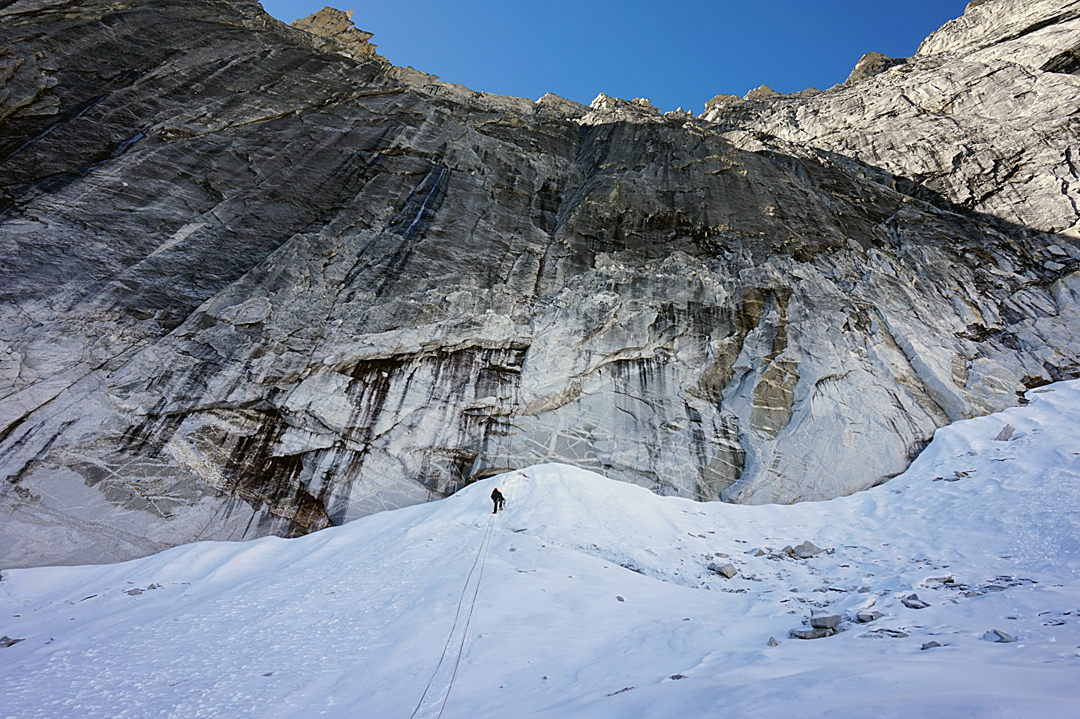 Marina Kopteva approaching the north face of Kemailong. The route followed the vertical corner system directly above.