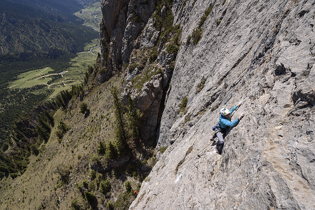 Ola Przybysz leading pitch two (5.11a) of Gate to Asgard on the south face of Zhawuduo.