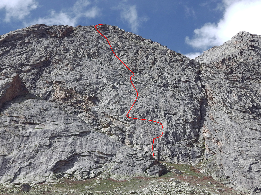 No Mind on the south face of Toro Peak. The route finishes on a rounded shoulder from which it is possible to descend on foot. The much higher main summit is visible up to the right. The obvious chimney-corner system on the right side of the wall is the initial section of the Lopez-Pfaff Direttissima. In 2017, a New Zealand team climbed direct from the start of the No Mind traverse to create Moving through Space (18).