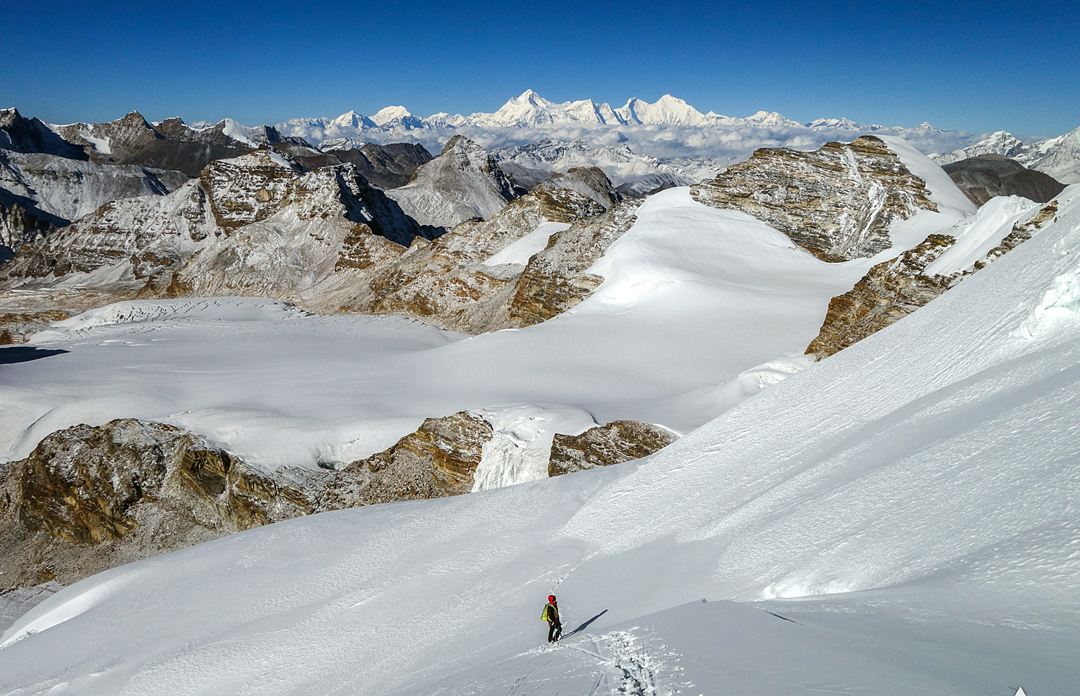 En route to the summit of Yanme Kang via the south face. In the background the Tibetan side of the Makalu–Everest ridge.