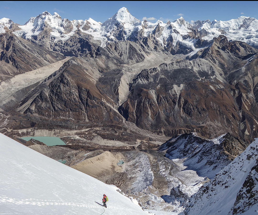 Nearing the top of Les Brasseurs Savoyacks, with a magnificent panorama of largely unclimbed peaks to the northeast. Dominant, more or less in the center, is Nangamari I. The high, triangular-topped peak near the left edge of the image, with an almost rocky summit area, is Lang Chung Kang.