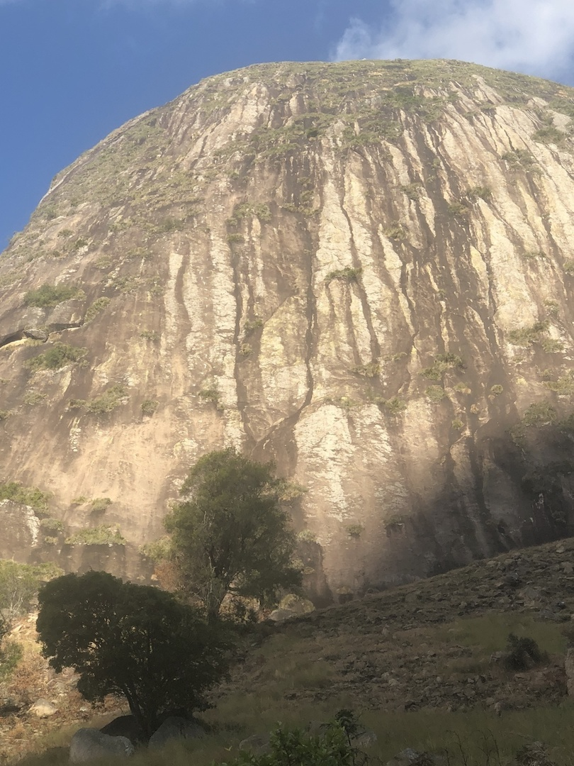 Tranokitily Dome from the trail. The route line of Sweet Avocado is obvious once the base of the wall is approached.