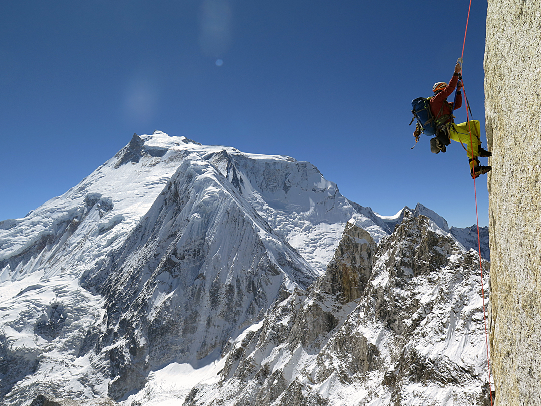 Jumaring pitch seven of Directa Ecuatoriana on the southeast face of Larkya Peak, with Manaslu behind.
