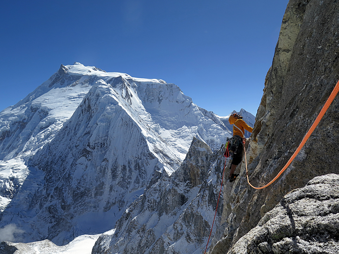 Setting out on pitch 10 of Directa Ecuatoriana on the southeast face of Larkya Peak, with Manaslu behind.