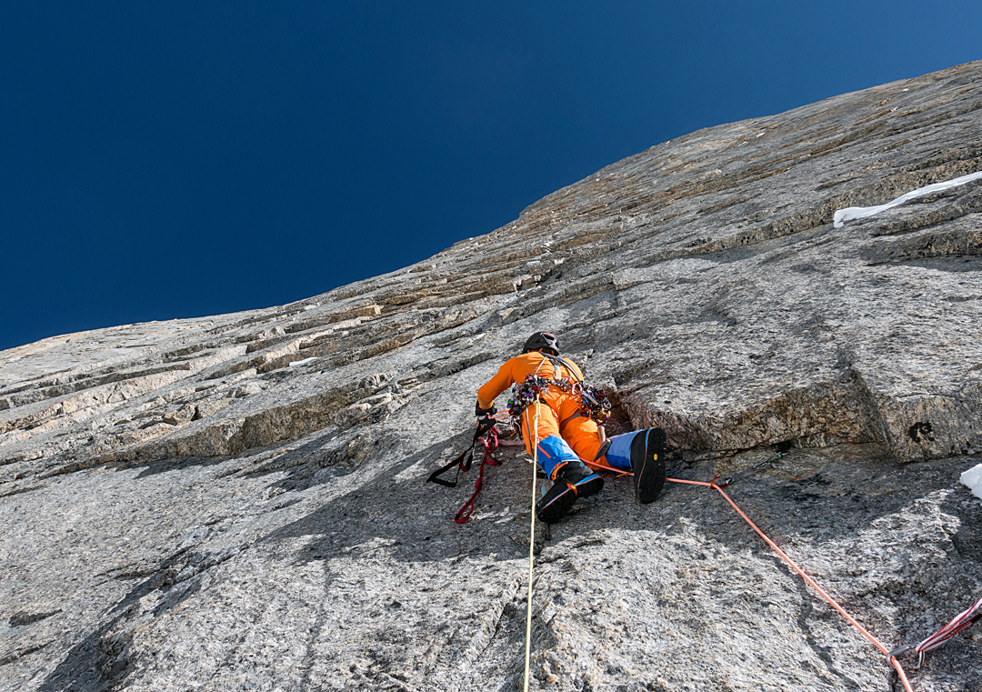 Stephan Siegrist leading the second A3 pitch high on the northwest face of Cerro Kishtwar in unaccustomed warmth and sunshine.