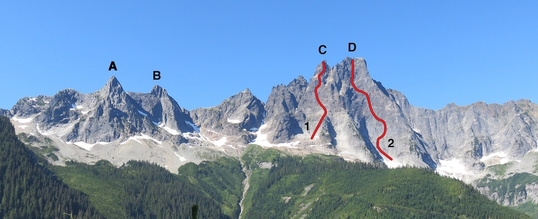 The Slesse group from the east, showing (A) Labour Day Horn, (B) Station D, (C) South Peak, and (D) Slesse Mountain. The 2017 traverses spanned the full massif from left to right. (1) Approximate line of Navigator Wall. (2) Approximate line of 2017 free variation to the east face of Slesse.