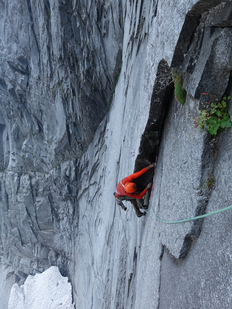 "Tony reaching into the ""glory layback"" on pitch four of the east face of Slesse."