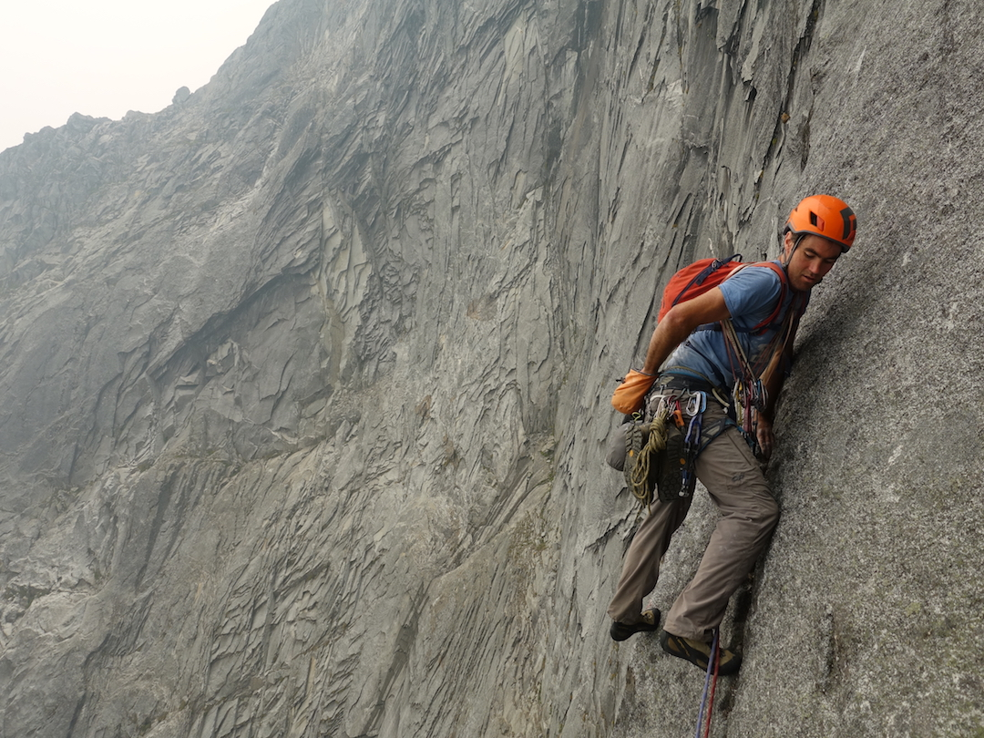 Tony McLane beginning the crux eighth pitch of the east face during the second Cook-McLane attempt.