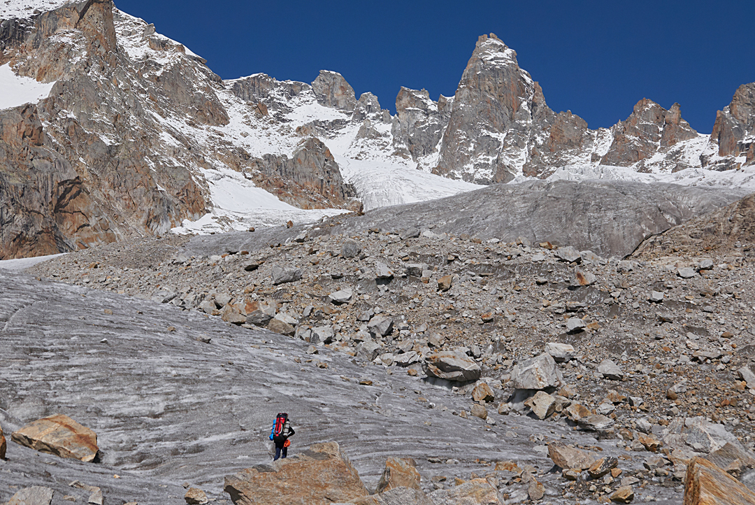 Approaching the rock tower of Peak 5,620m on the upper section of the glacier west of base camp. The peak was climbed by the right skyline ridge.