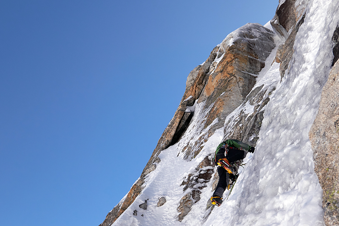 An ice runnel on the headwall of the east ridge of Peak 5,620m. The route continued directly through the slot above the climber.