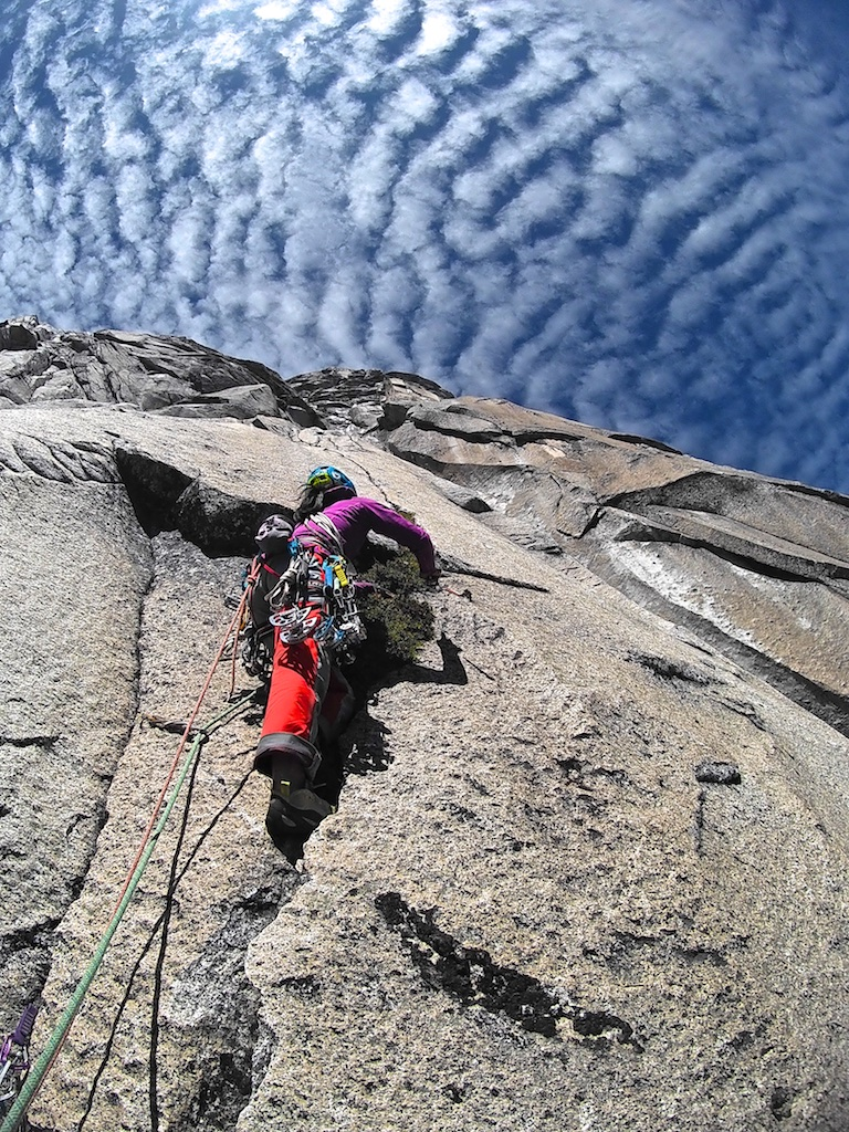 Szu-ting Yi doing some big-wall gardening at the start of the crux pitch of Rising from the Ashes (880m, 5.11 C1) on Cerro Esquinero, in Argentina's Nahuel Huapi National Park.