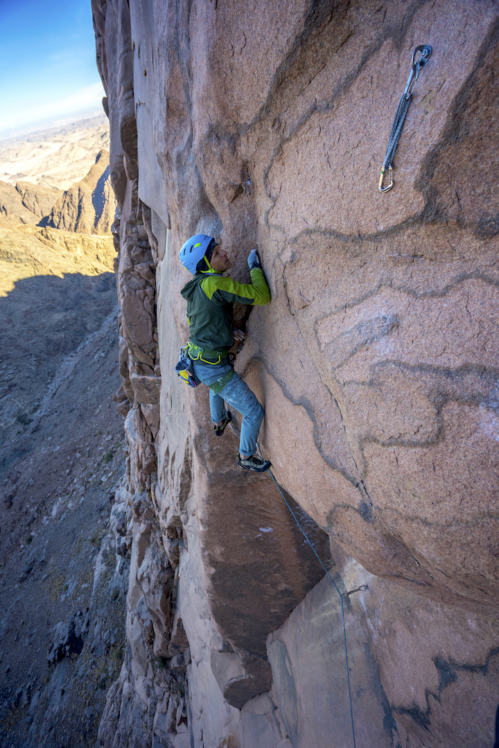 Kyle Elmquist working the 5.13 third pitch of the Sheikh on Jebel Naja.