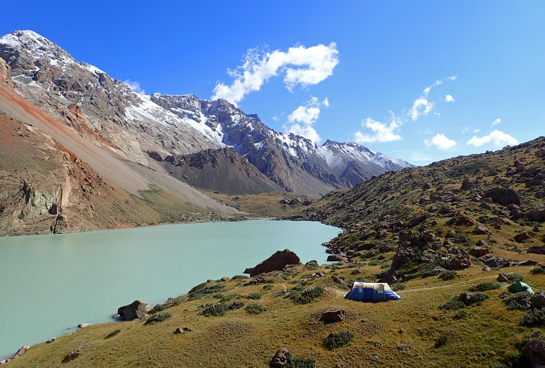 The idyllic base camp on the southern shores of Kainar Lake. Several summits on the ridge above were climbed by the 2017 expedition.