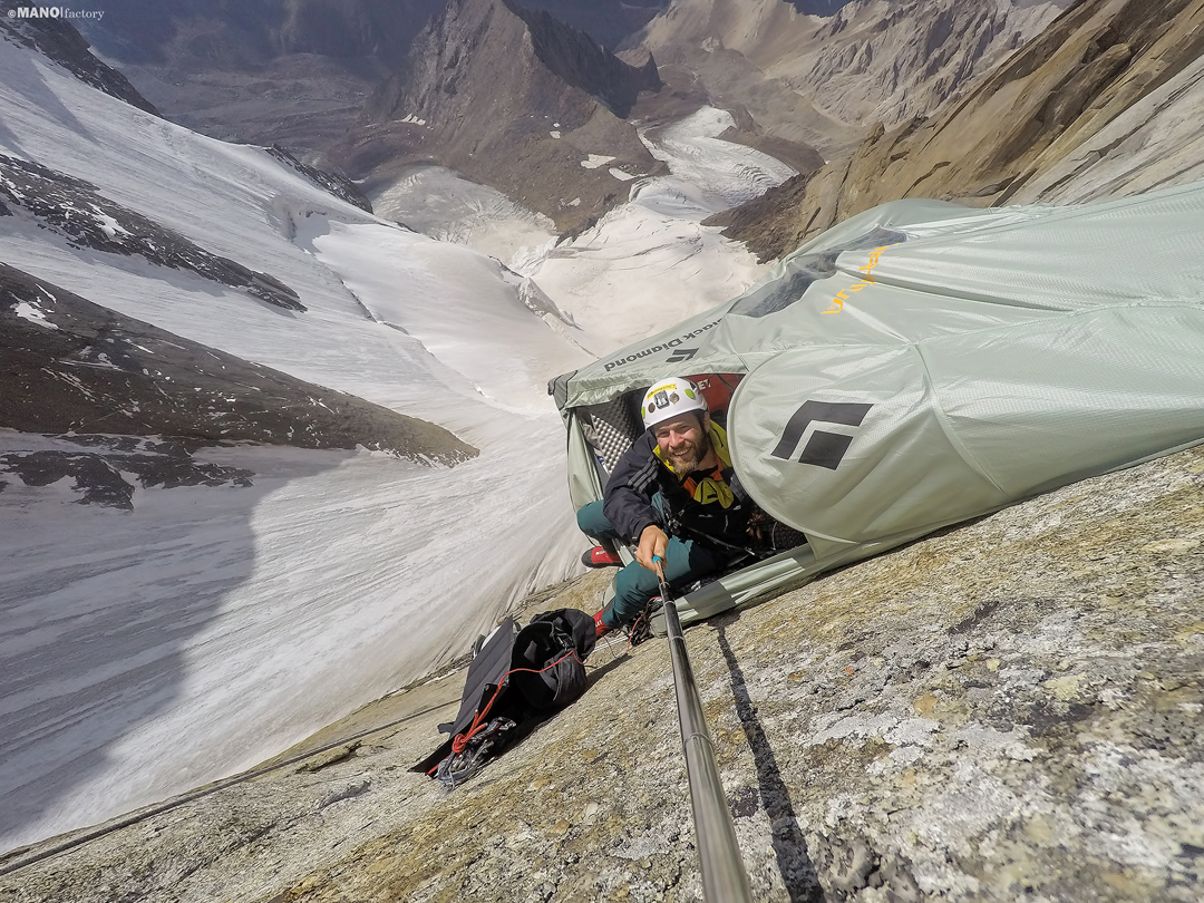 Martin Grajciar at the portaledge camp with the glacier approach below.