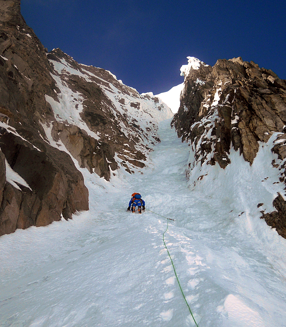 Marek Holecek heading up the couloir of Bloody Nose on Monte Pizduch. The summit cornice looms above.