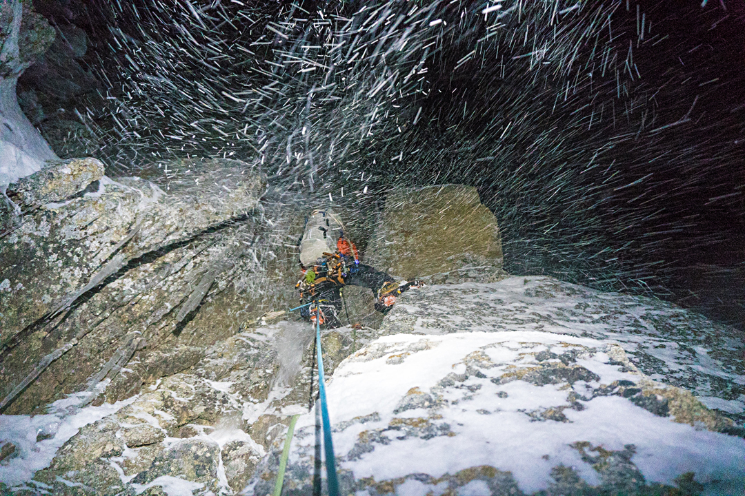 Chris Wright working hard on steep mixed ground during a stormy attempt on Link Sar's east face.
