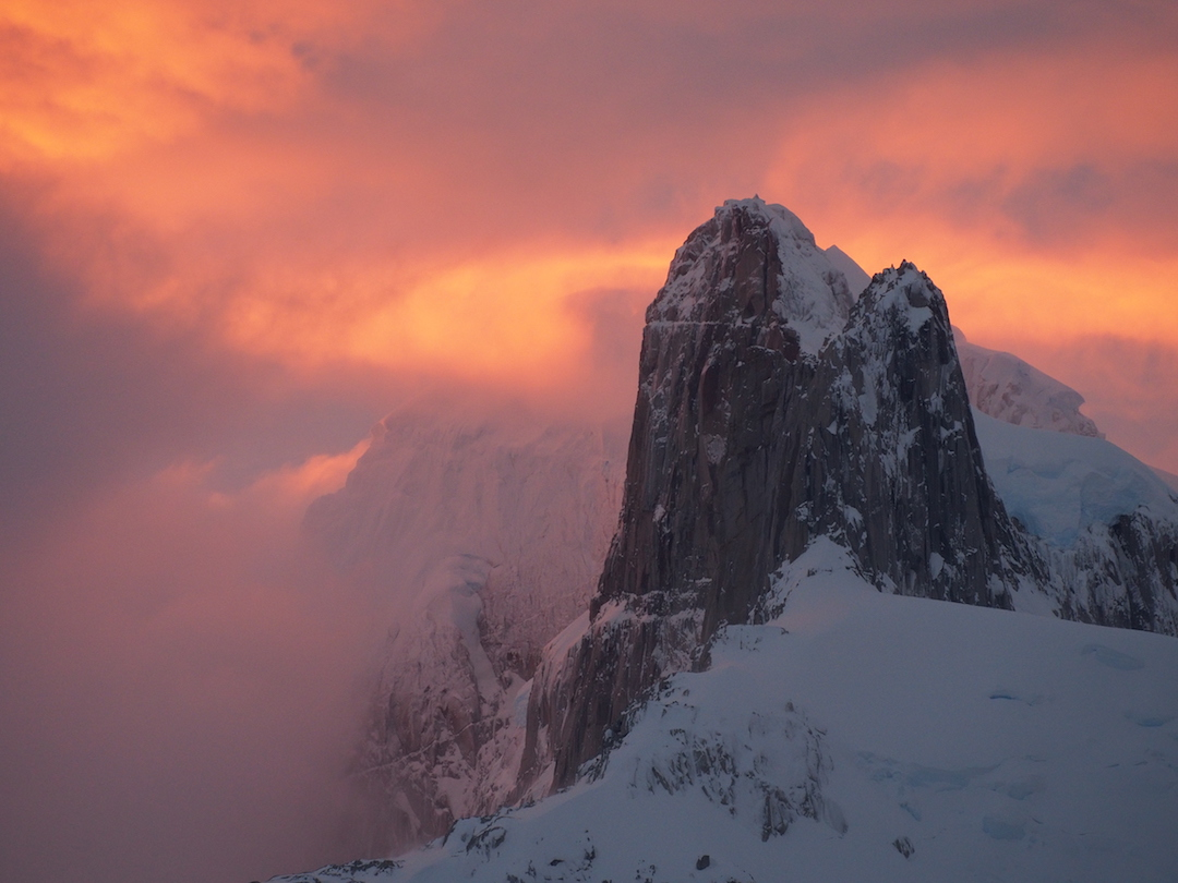 Unnamed peaks and walls near Cerro Largo in the warm, soft light of sunset.