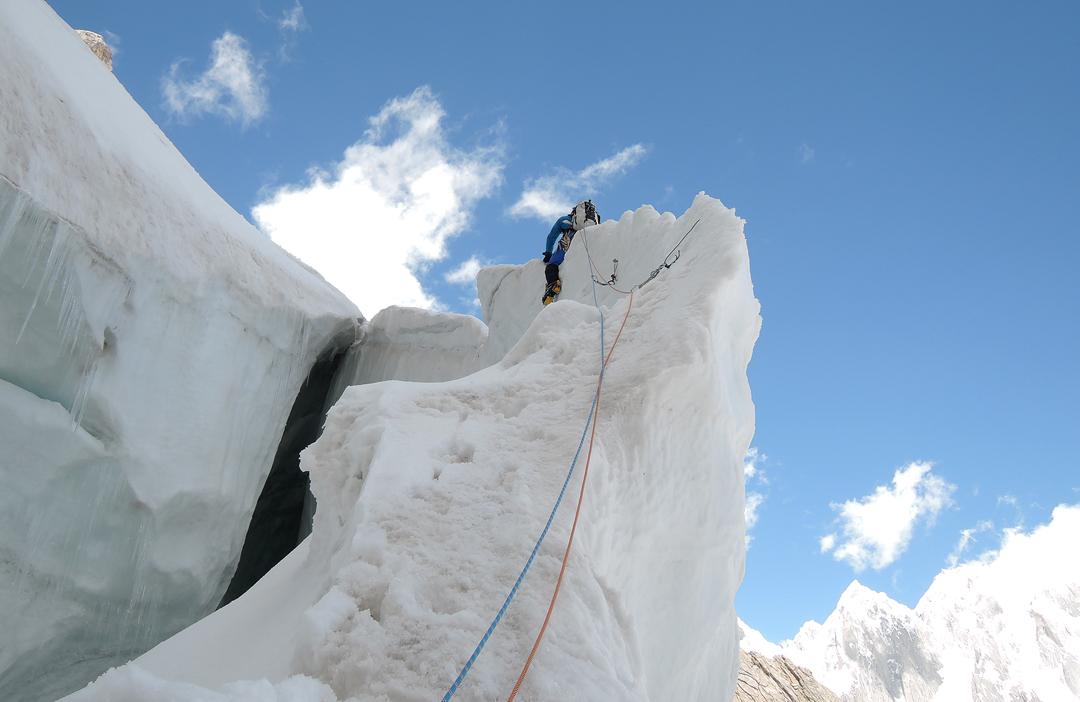 Gian Luca Cavalli riding an ice fin during the first ascent of Amman in Kashmir on Fiost Brakk.