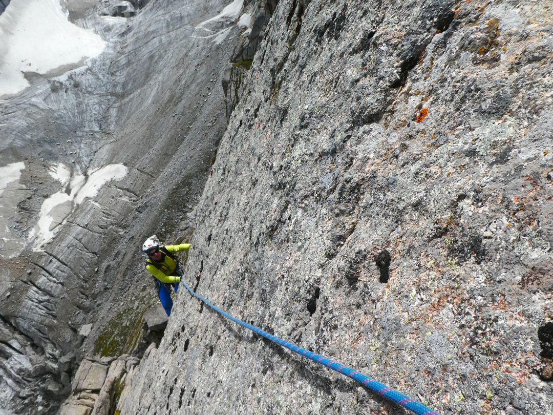 Marcello Sanguineti on the compact slabs of Via delle Poiane, Punta Città di Biella. The rock offered great friction but scant protection.
