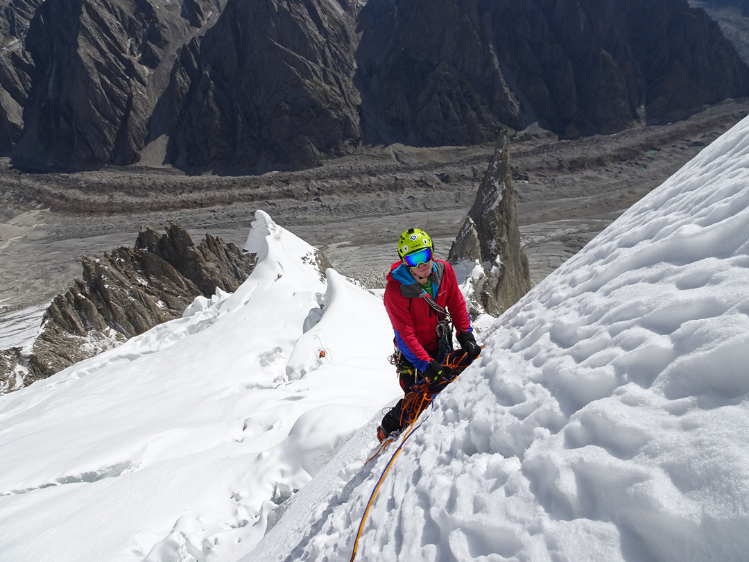 Tom Ballard on the northeast face of Link Sar. Camp 2 at 5,200m is visible below. The approach couloir came up to looker's right of the prominent rock pinnacle.