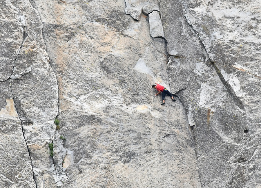 Alex Honnold completing the downclimb before traversing left to Hollow Flake. The 5.12a variation is one key to free climbing the Salathé and Freerider. Preparing for his solo, Honnold sought an alternative to the downclimb but eventually committed to simply rehearsing the moves. A friend revealed a hidden hold that made this section feel secure.