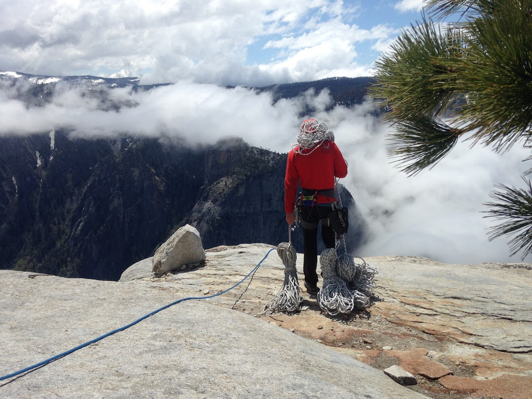 Honnold on top of El Capitan, preparing to fix ropes to work on the climb.