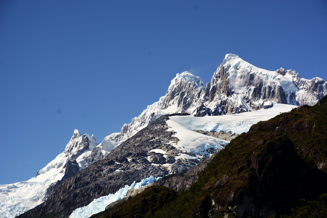 Telephoto image of the Riso Patrón peaks from base camp to the south-southwest, with the main summit on the left and south peak on the right.
