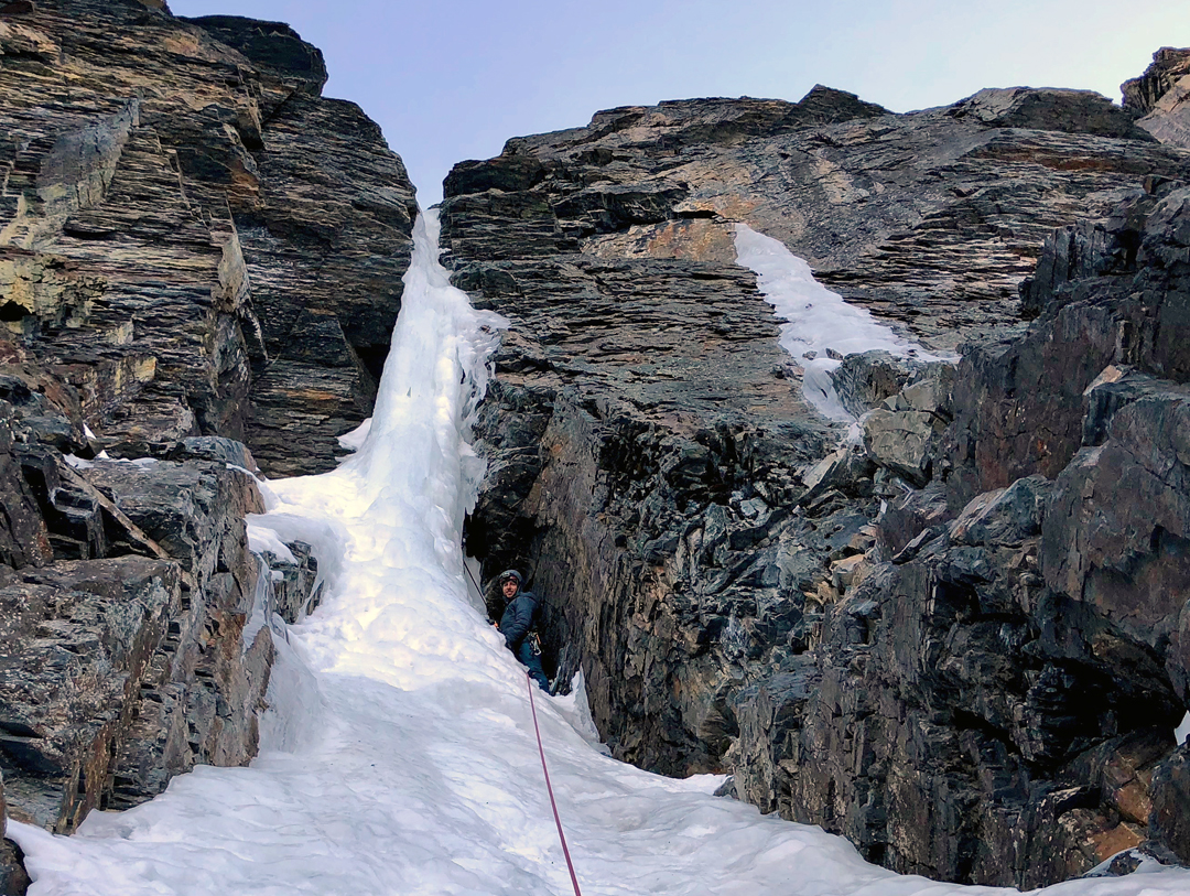 Ethan Berman at the belay below the crux ice pillar on Power to the Process, Mururata south face.