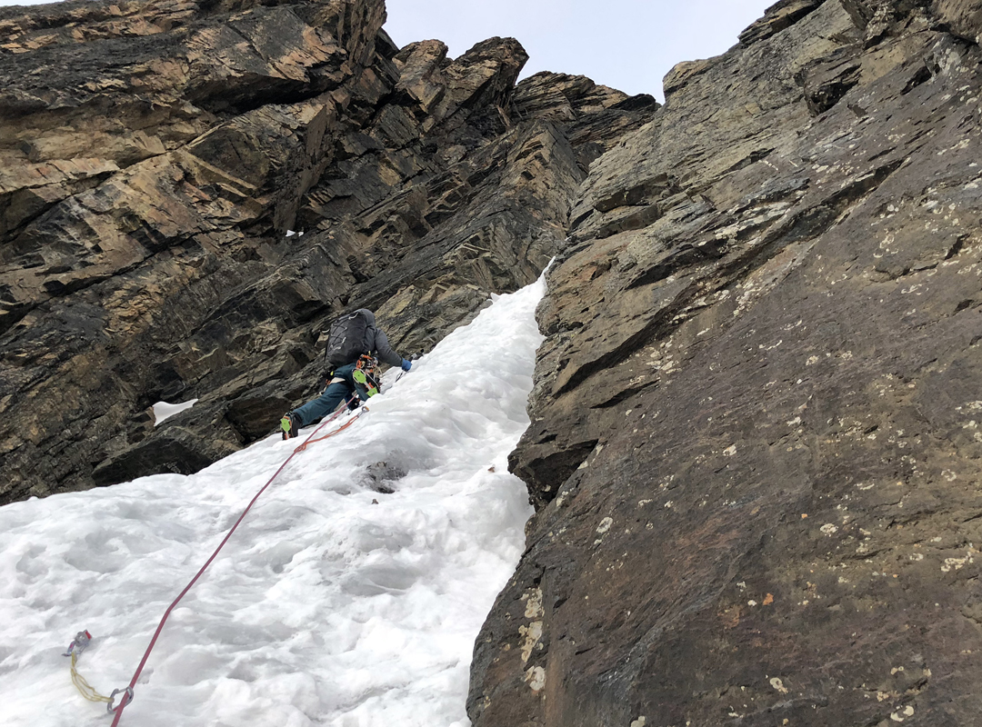 Ethan Berman on the initial ice pitch above the first snowfield on Power to the Process, Mururata south face.