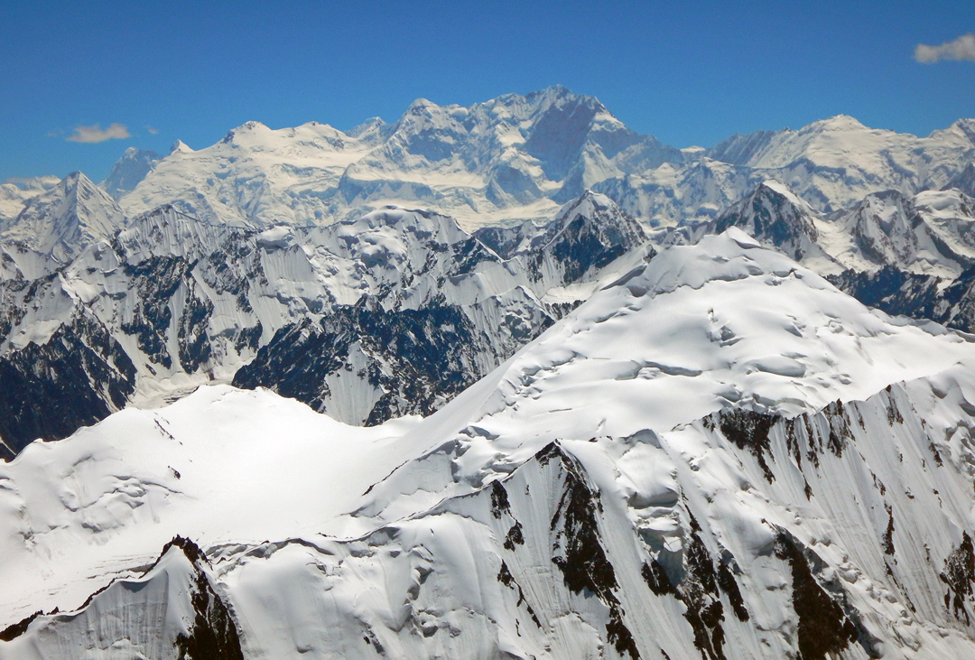 A panorama south from the Fifth Koksil Glacier. Center stage is the somber north face of Distaghil Sar, while the broad snowy pyramid to its right is Malungatti Sar.