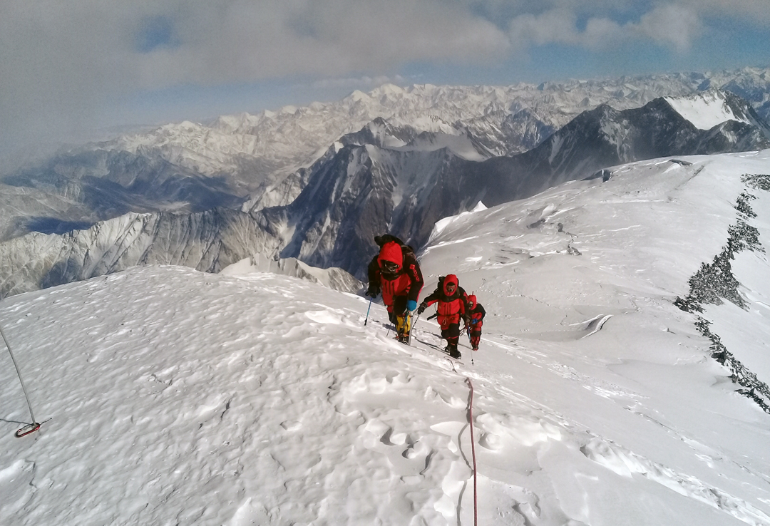 Reaching the summit of Pik Korzhenevskaya on January 22, via the south face, with the rounded upper section of the northwest ridge below.