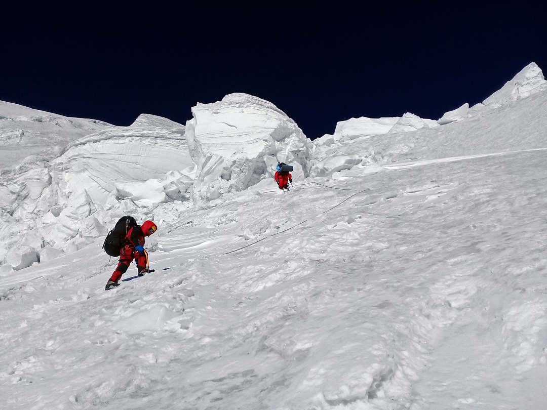 Climbing through seracs on the first section of the hanging glacier on the upper south face of Korzhenevskaya, heading for the top camp at 6,450m.