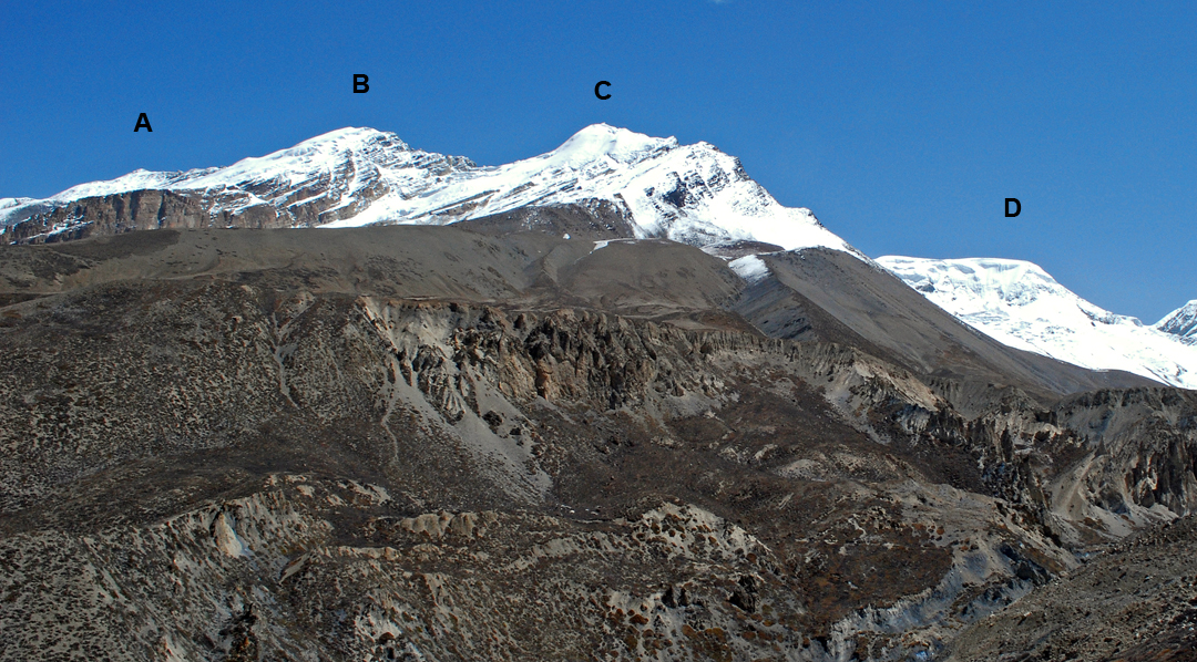 The Nagoru Peaks seen from slopes above the valley of the Jyamdau Khola to the south. (A) Nagoru West (6,076m), (B) Nagoru Central (6,165m), (C) Nagoru East (6,116m), and (D) Nagoru Far East (6,145m). See also a photo in AAJ 2017, when conditions were much drier.