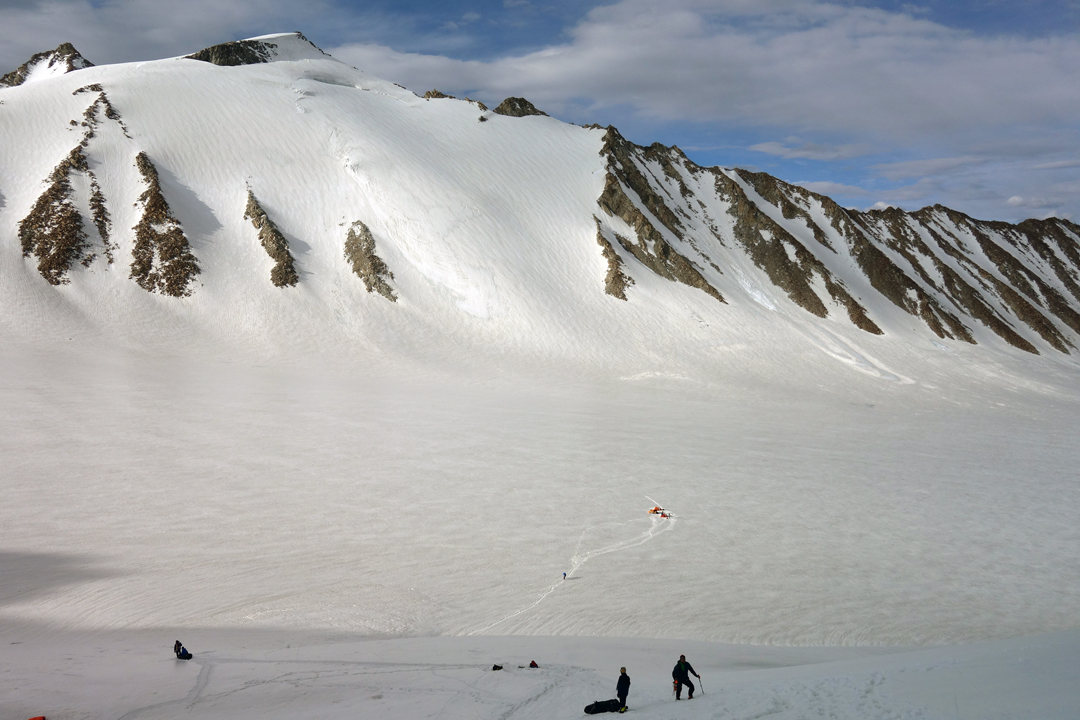 Descending to the Phurdukpa Glacier from Estonian Col on July 16, 2018, with an unclimbed peak in the background. The tents lie at the site of that night's camp.